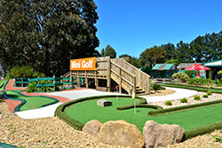kids having fun playing on another Mini Golf hole